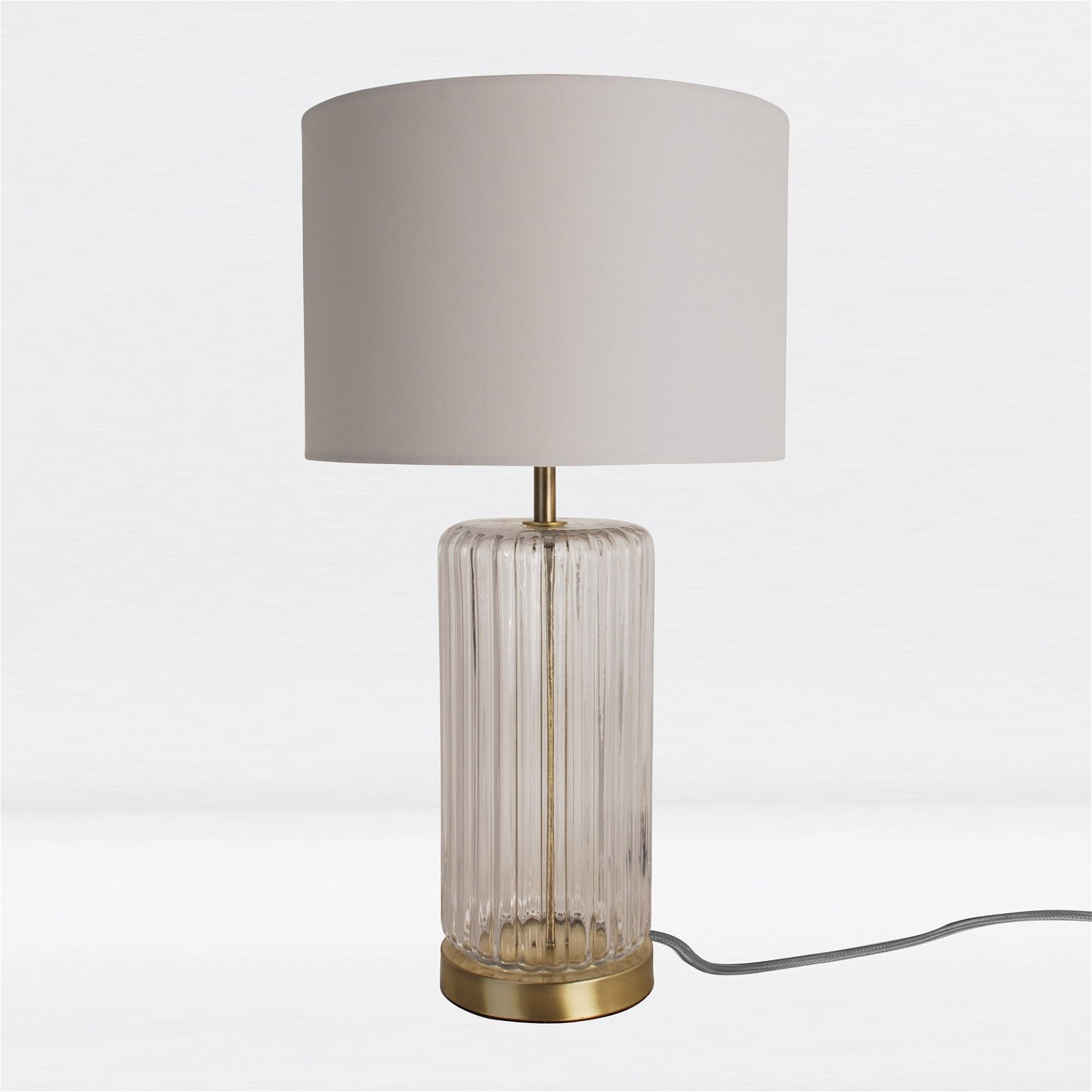 Fluted Design Table Lamp Finished In Clear Glass And Bronze Effect Colour With A Ivory Woven Rolled Edge Cylinder Fabric Shade